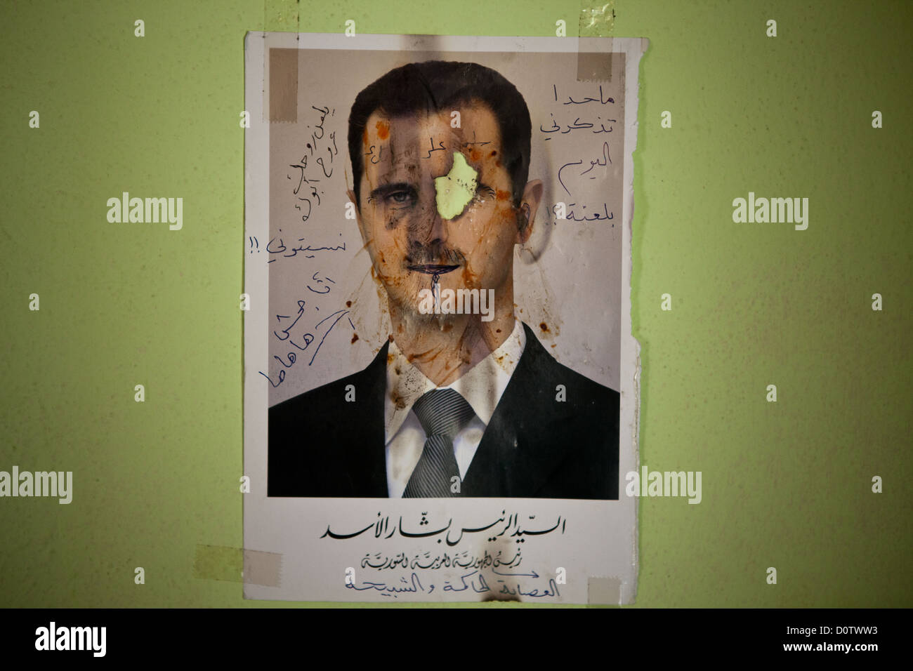 01/10/12, Syria. Photograph of Bashar al-Assad adorns a hospital wall. A patient who had lost an eye took a lighter - Stock Image