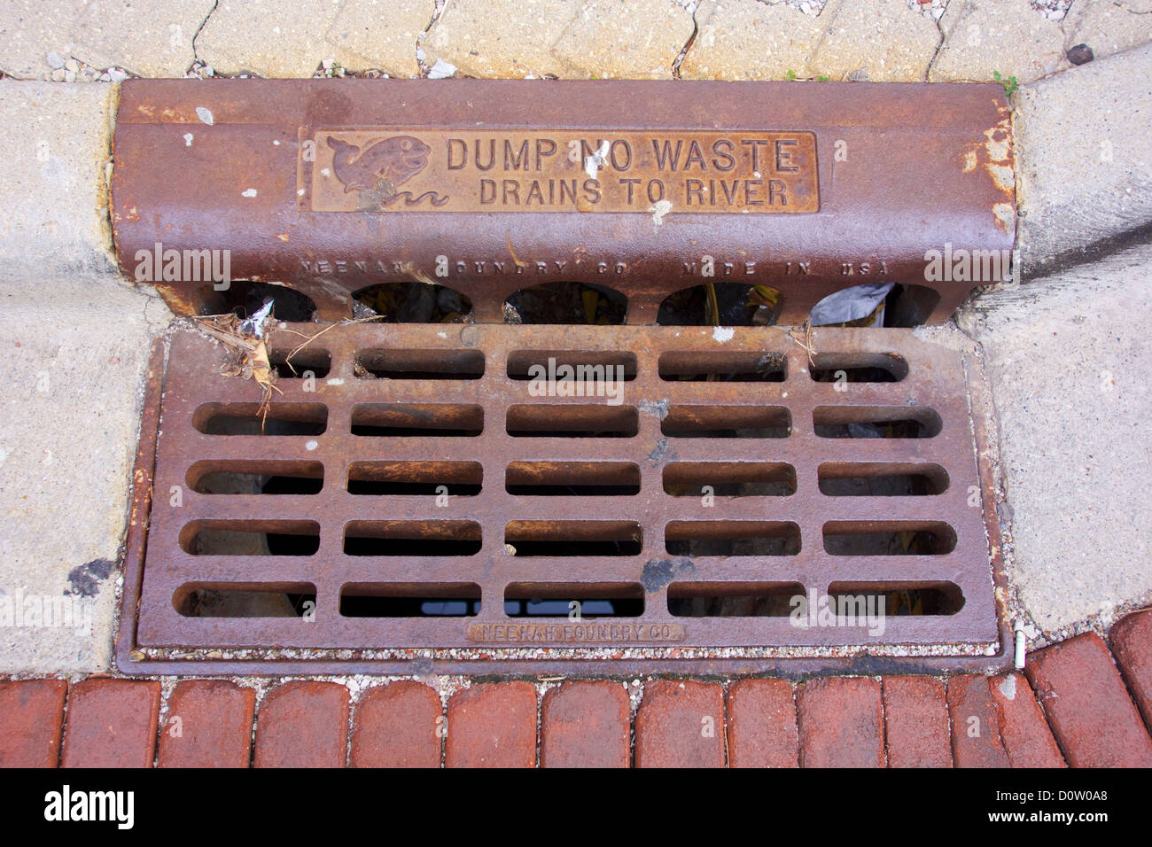 Storm drain grate with dump no waste drains to river warning. Oak Park Illinois - Stock Image