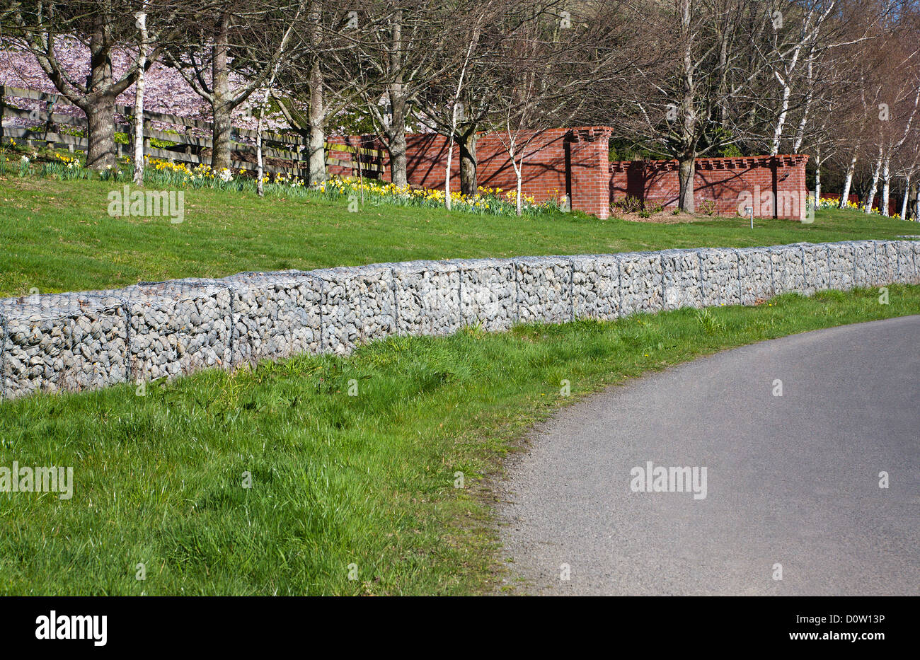 A structural crib retaining wall made of Gabion baskets using stones and galvanized wire. - Stock Image