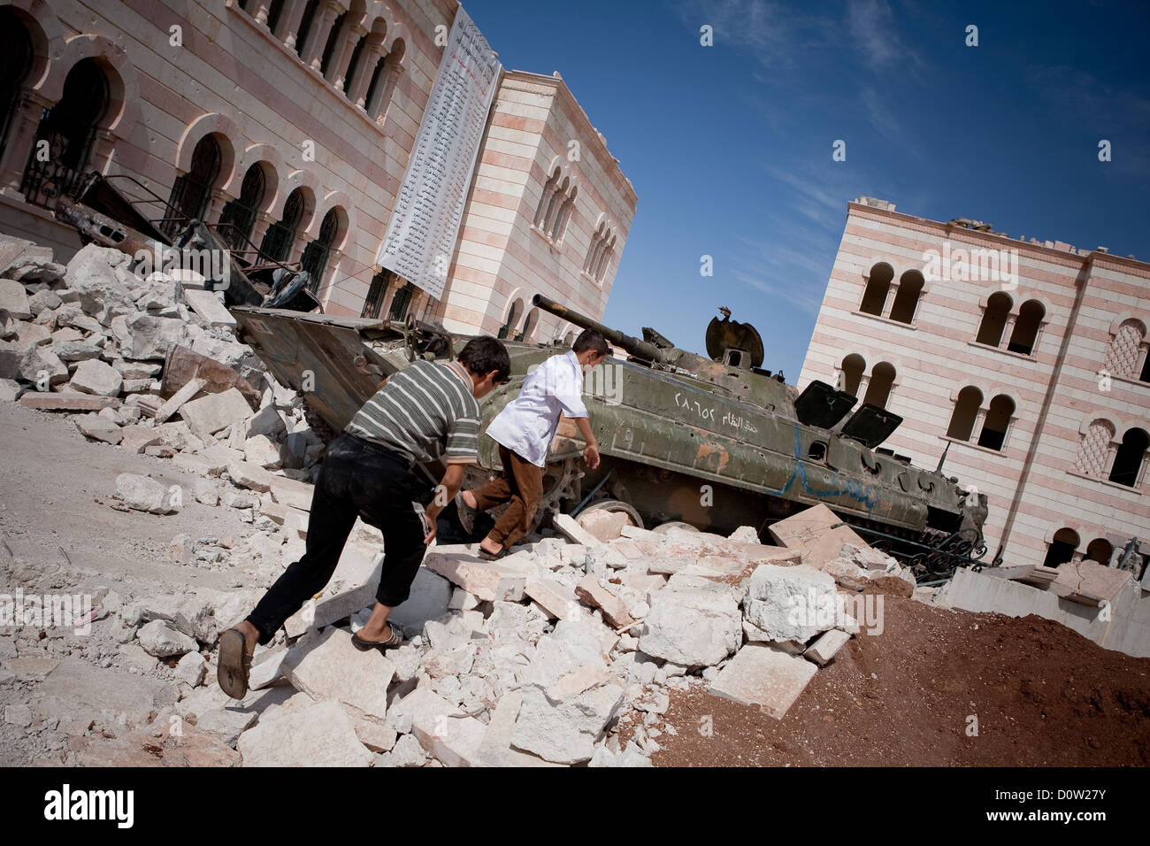5/10/12, Azaz, Syria. A disabled APC outside the mosque in Azaz. The banner in the background records the towns - Stock Image