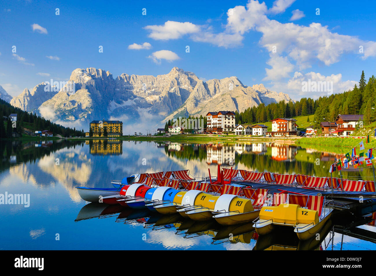 Italy, Europe, travel, Dolomite, Alps, Missurina, Lake, pedalo, boats, clouds, colourful, mountains, reflection, - Stock Image