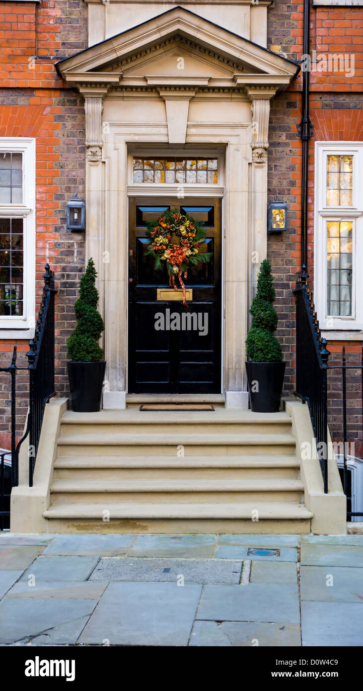 black door with christmas garland - Stock Image