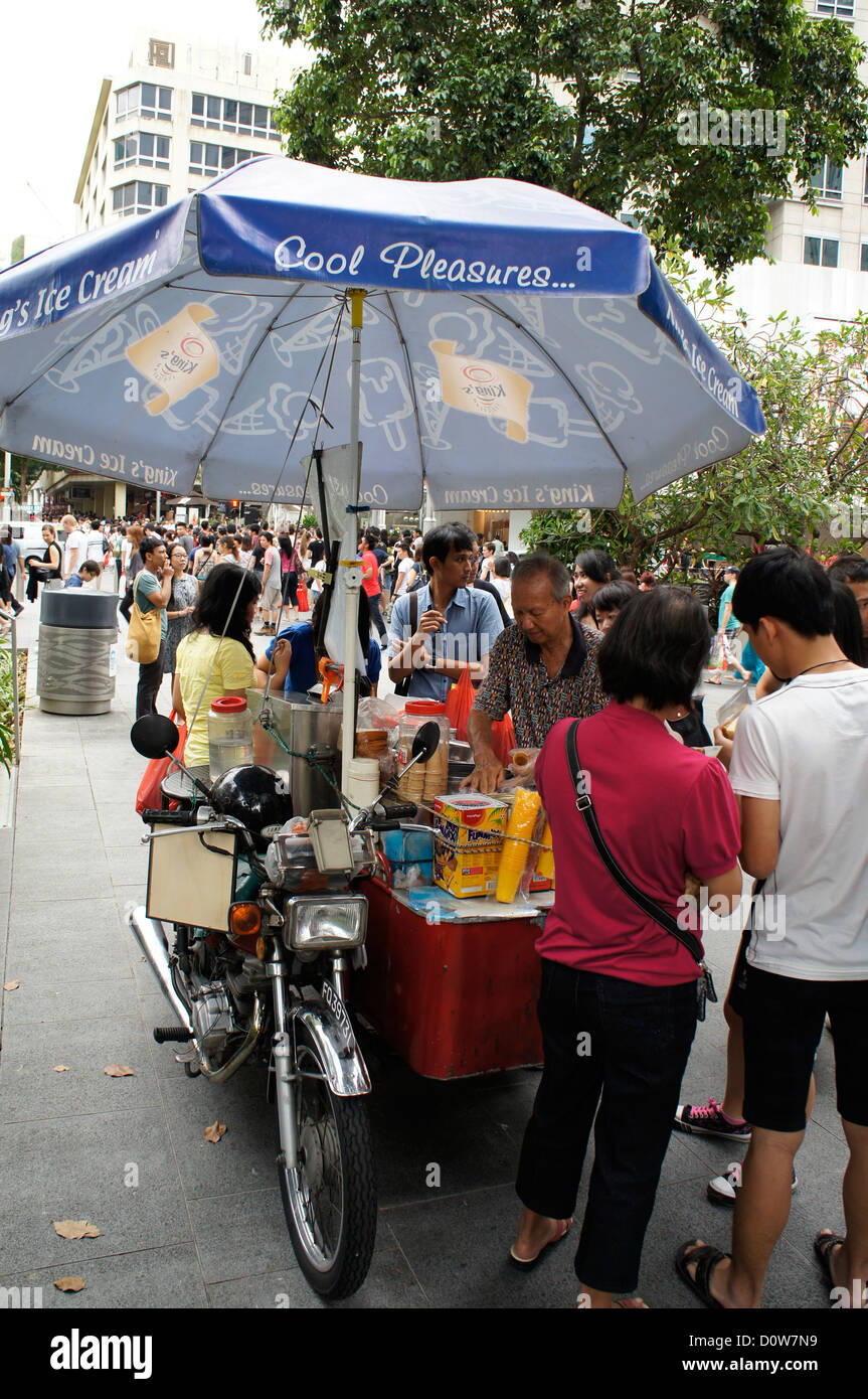 ice cream seller on a hot day at Orchard Road, Singapore - Stock Image
