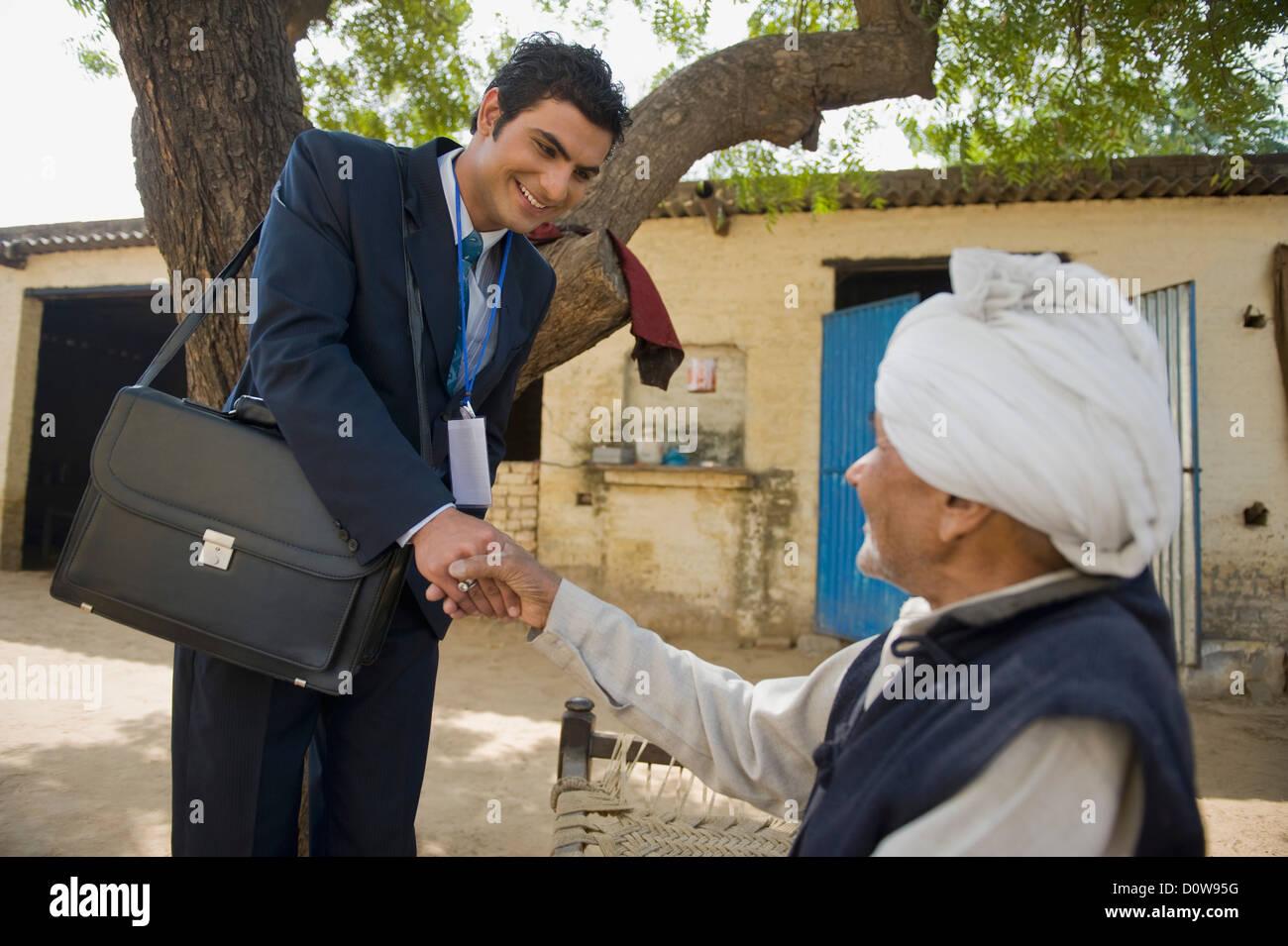 Financial advisor shaking hands with a farmer, Hasanpur, Haryana Stock  Photo - Alamy