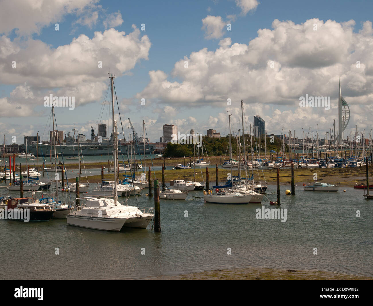 View from Gosport of Portsmouth harbour showing Royal Navy ship HMS Illustrious berthed up and the Spinnaker Tower - Stock Image