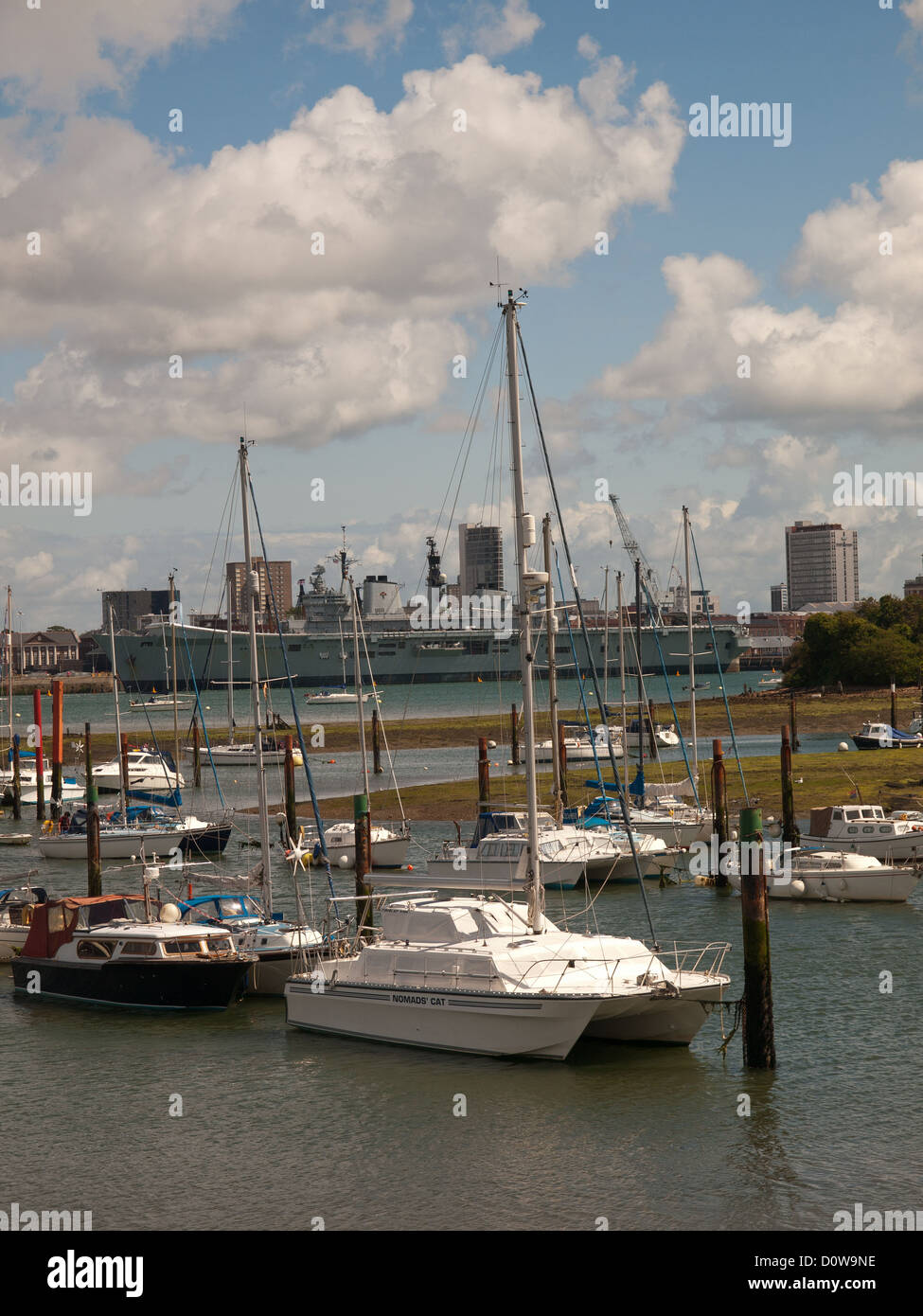 View from Gosport of Portsmouth harbour showing Royal Navy ship HMS Illustrious berthed up. - Stock Image