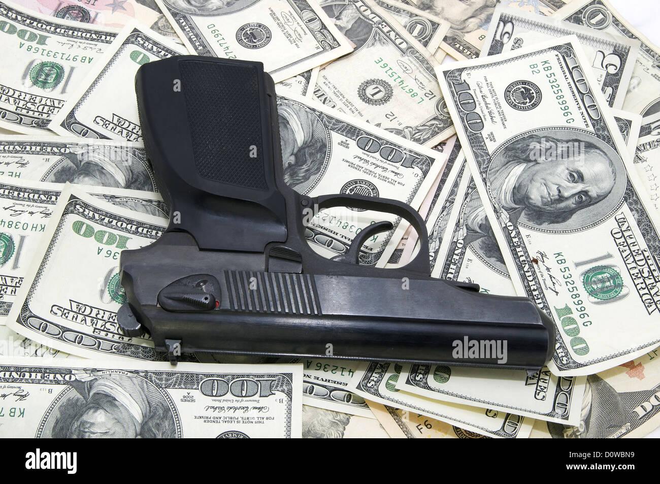 Gun and dollars - Stock Image