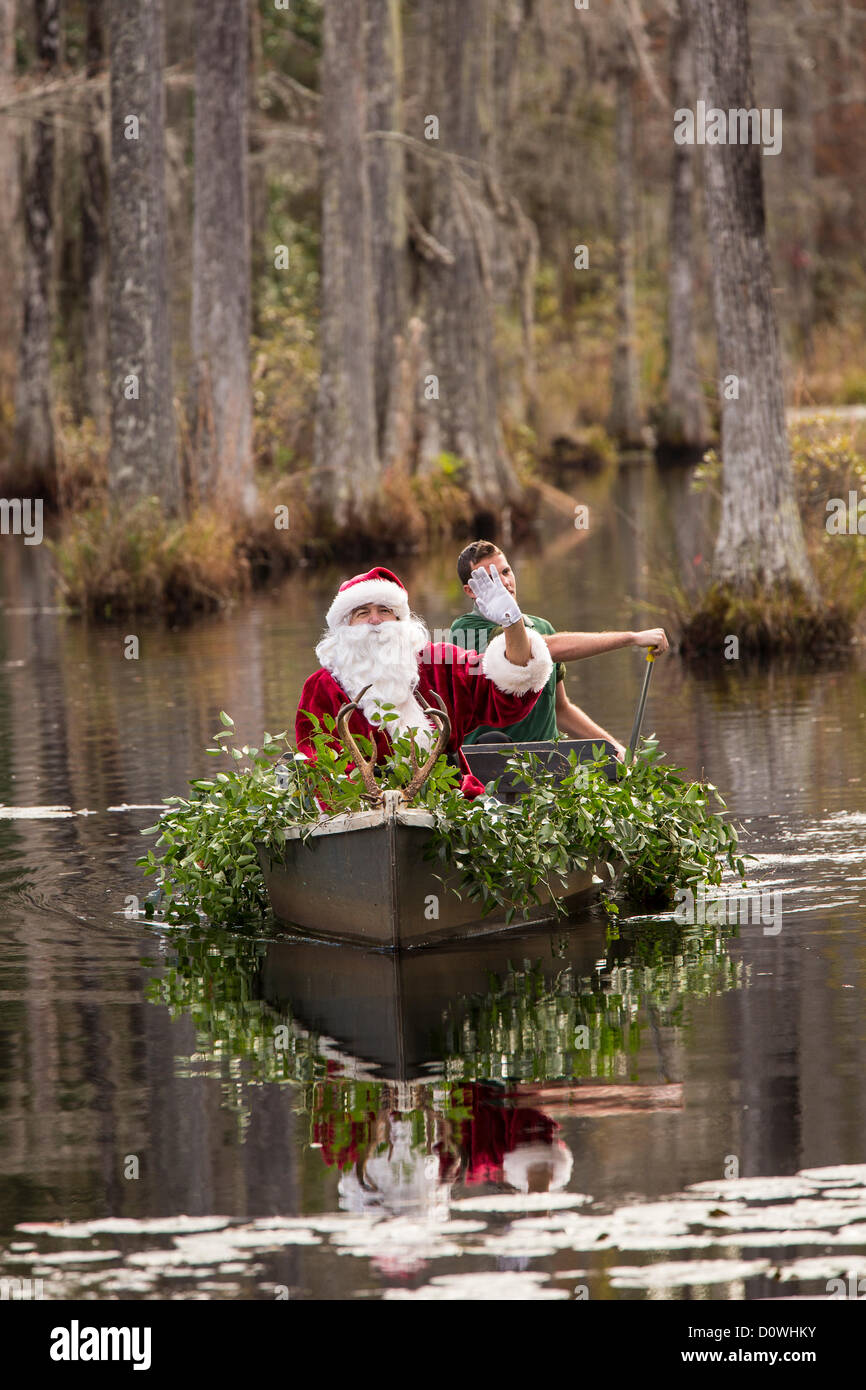 Charleston, USA. 1st December 2012. Santa Claus arrives by swamp boat at Cypress Gardens Swamp December 1, 2012 Stock Photo