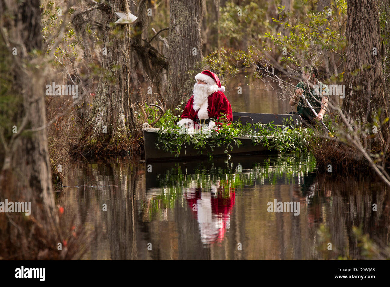 Charleston, USA. 1st December 2012. Santa Claus arrives by swamp boat at Cypress Gardens Swamp December 1, 2012 Stock Photo