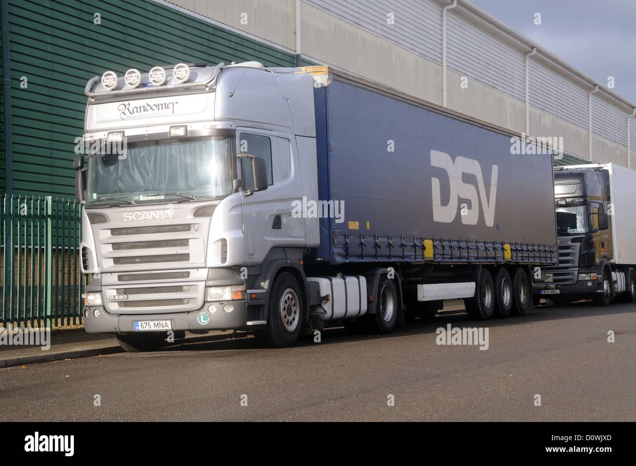 A 'Randomer' Estonian registered Scania R420 tractor unit with a trailer in DSV livery in Leicester, Leicestershire, - Stock Image