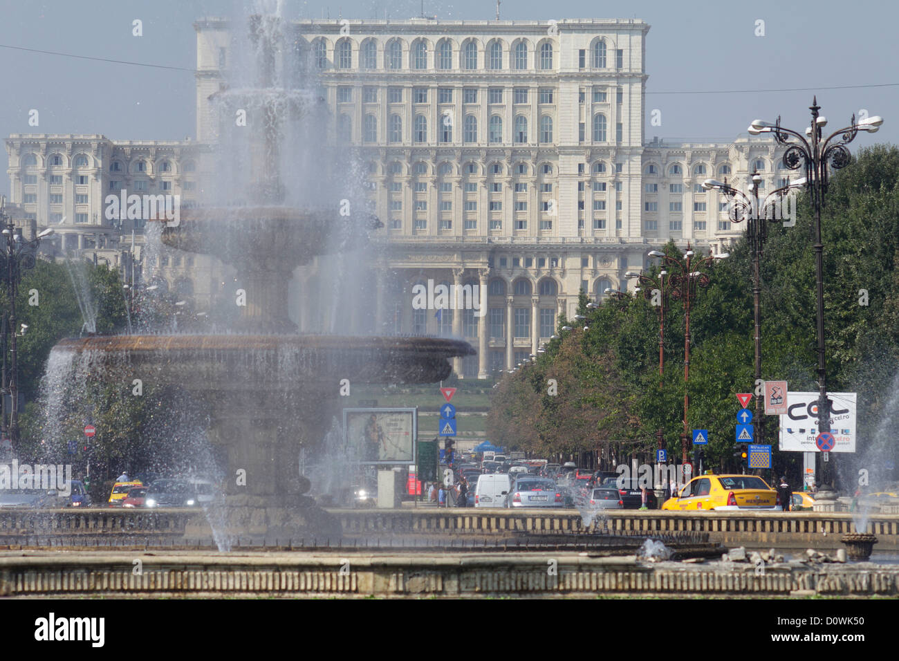 Bucharest, Romania, the fountain at the Unity Square and Palace of the Parliament Stock Photo