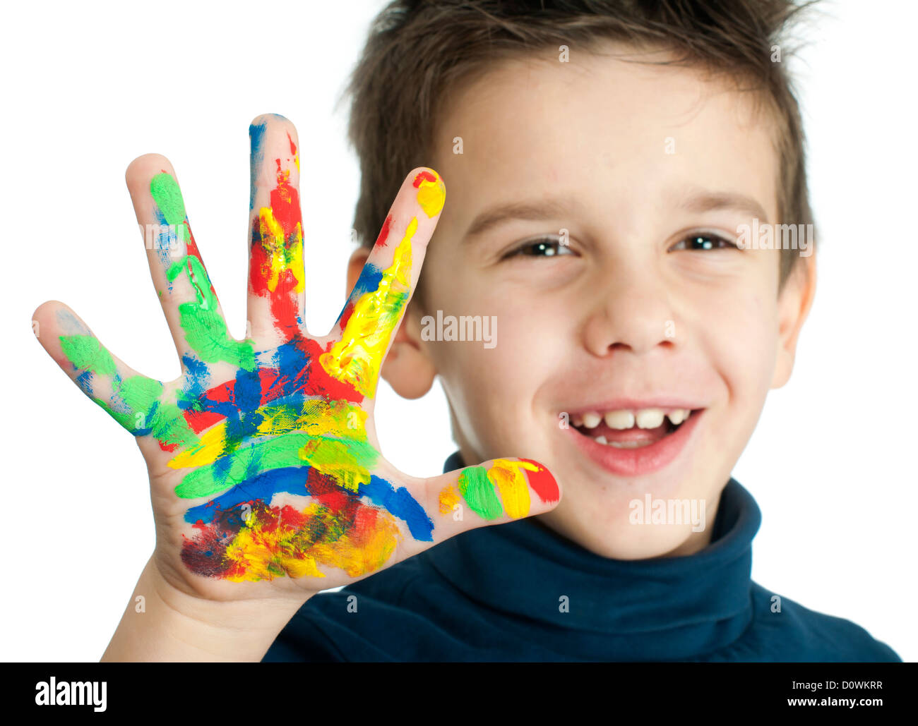 Boy hands painted with colorful paint. White islated smiling child - Stock Image