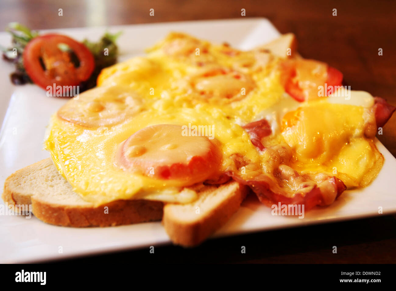 An Uitsmaker, fried egg served on toasted bread, is served in Amsterdam, the Netherlands. - Stock Image