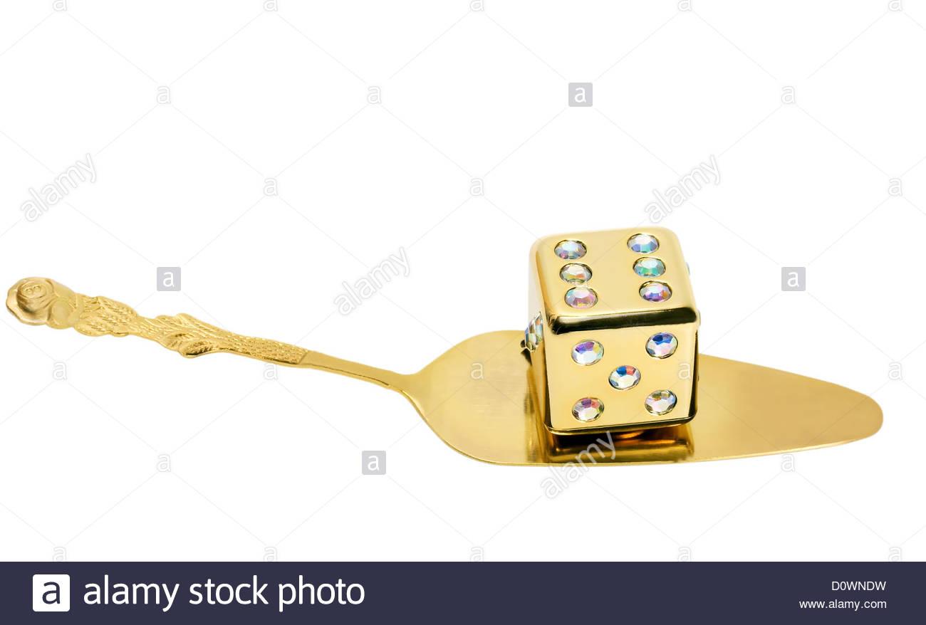 dice on golden spoon Stock Photo