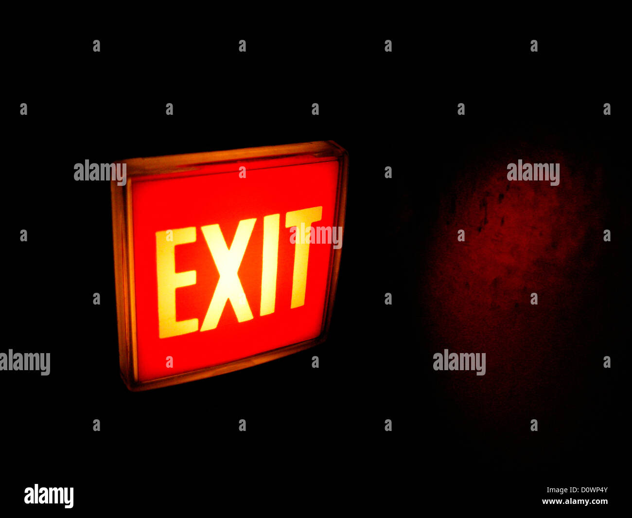 an Exit sign hangs in an apartment house hallway in Astoria, Queens NY. ©mak - Stock Image