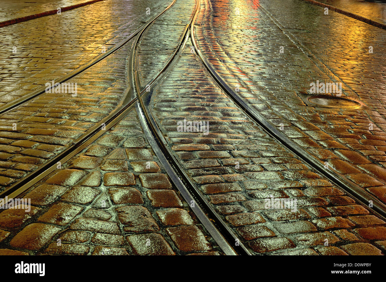 old stone pavement and the tram rails - Stock Image
