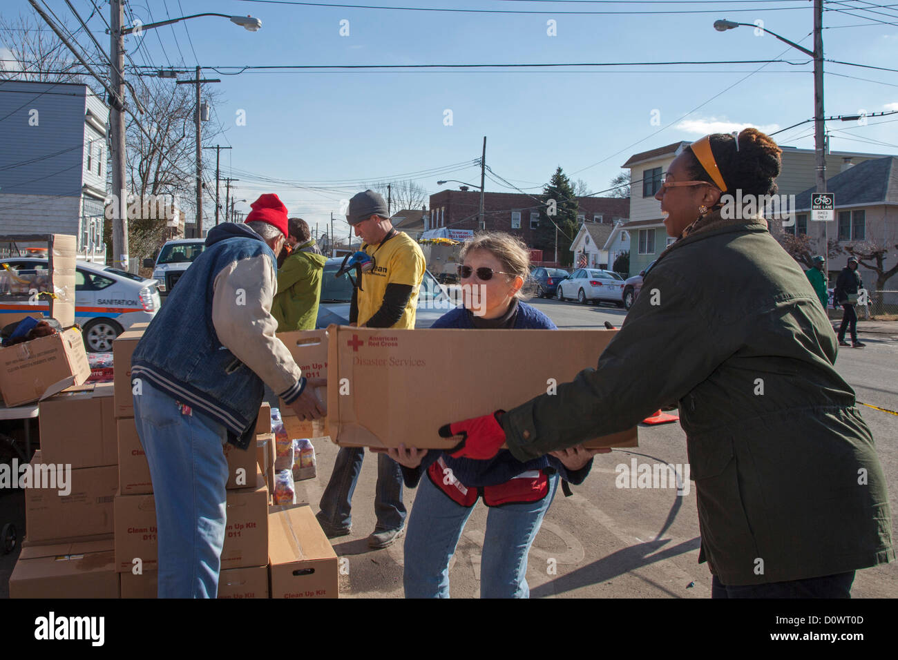 New York, NY - Volunteers on Staten Island help with the recovery from Hurricane Sandy. Stock Photo