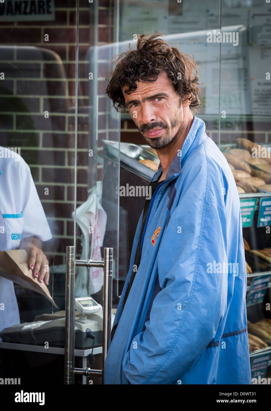 BUCHAREST, ROMANIA - September 29, 2012: Man standing in front of a bakery window in Bucharest. Stock Photo