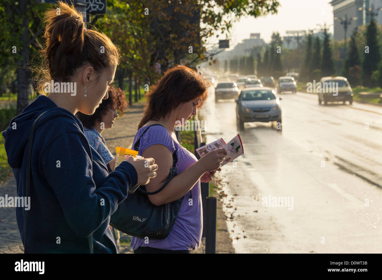 BUCHAREST, ROMANIA - September 29, 2012: People waiting to cross the Bulevardul Unirii in downtown Bucharest. Stock Photo