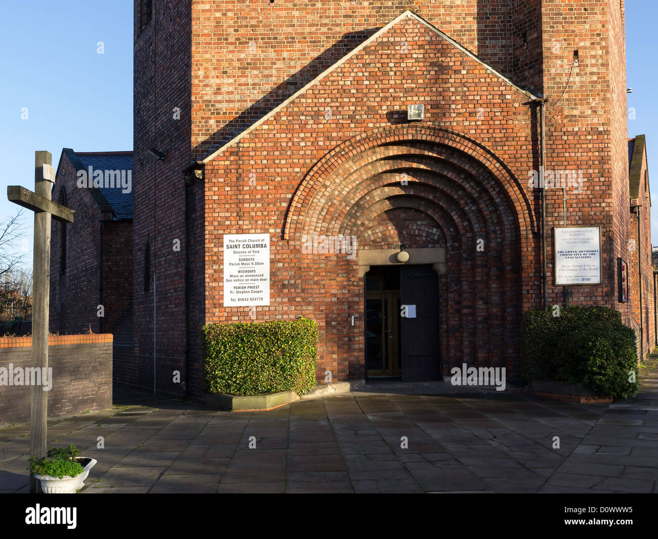 Entrance doorway with semi circular red brick arch surround at St. Columba's Anglican church in Middlesbrough built Stock Photo