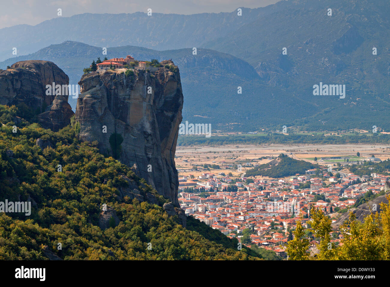 Monastery of saint Trinity at Meteora of Kalambaka in Greece and view of the city below the rocks - Stock Image