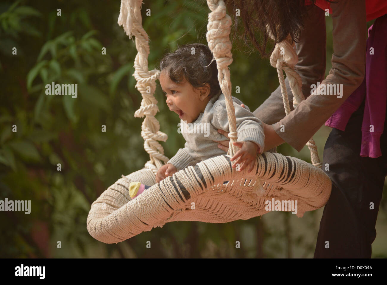 cute indian child on a swing stock photos & cute indian child on a