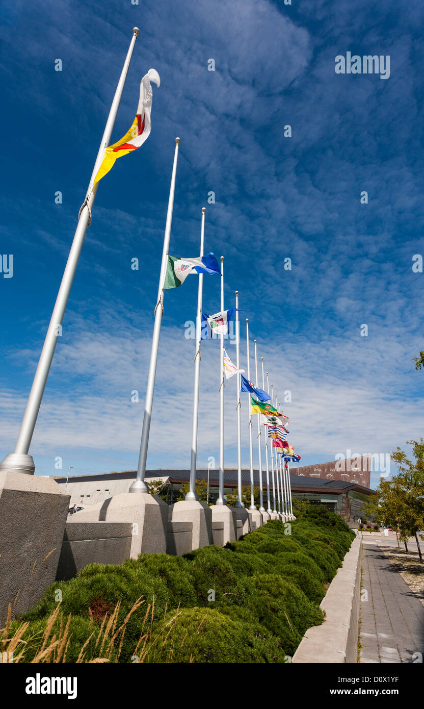 Half Mast Flags at the War Museum. A row of Canadian provincial flags flying at half mast in front of Canada's - Stock Image