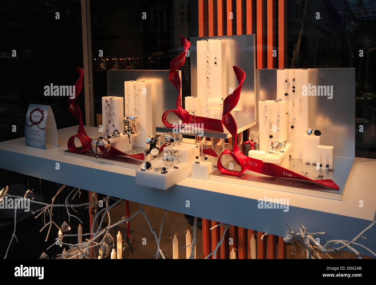 The Georg Jensen silversmith life style shop's Christmas display on pedestrian and shopping street Strøget - Stock Image