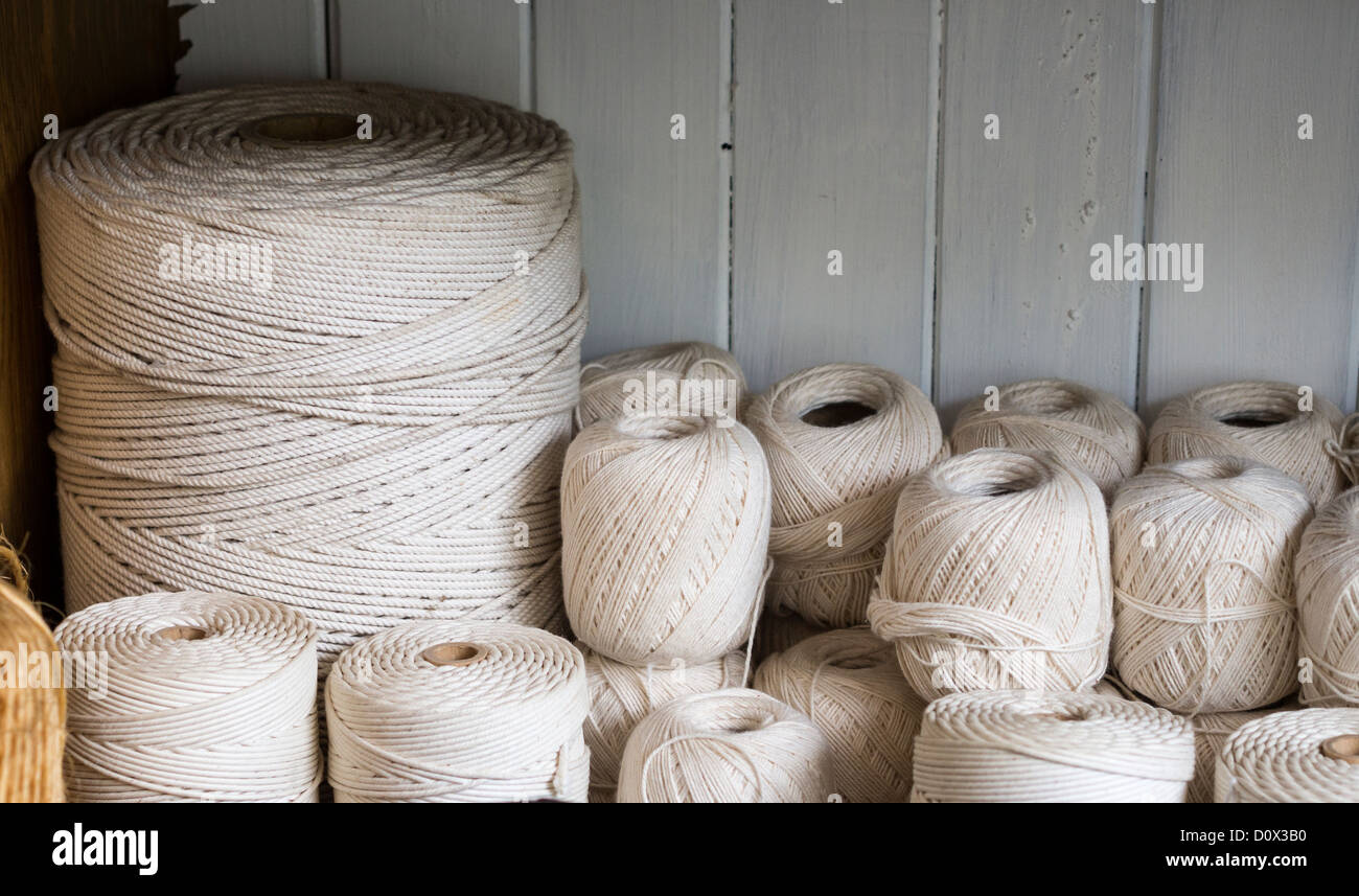 A pile of string. A collection of spools of cotton string of various gauges. - Stock Image
