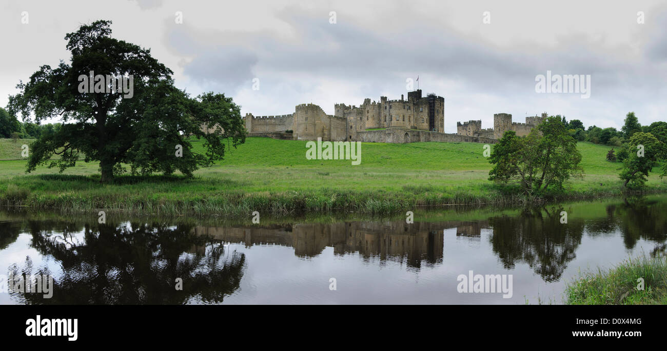 Panorama image of Alnwick Castle reflecting in the river Aln- Northumberland - Great Britain - United Kingdom - - Stock Image