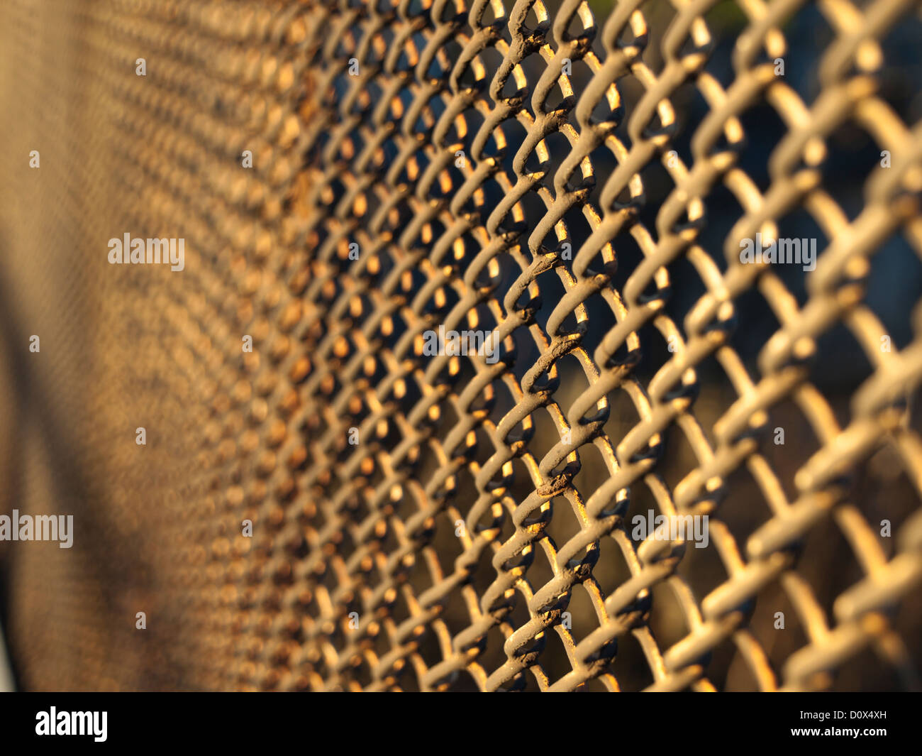 Fine meshed wire rusty wire fence, selective focus close up - Stock Image