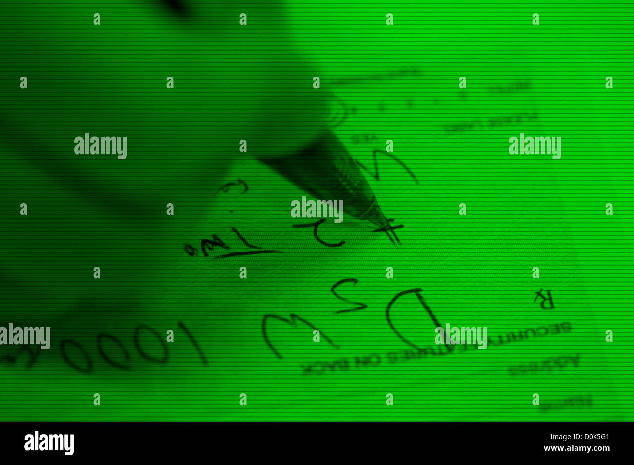night vision image closeup hand writing illegal drug prescription - Stock Image