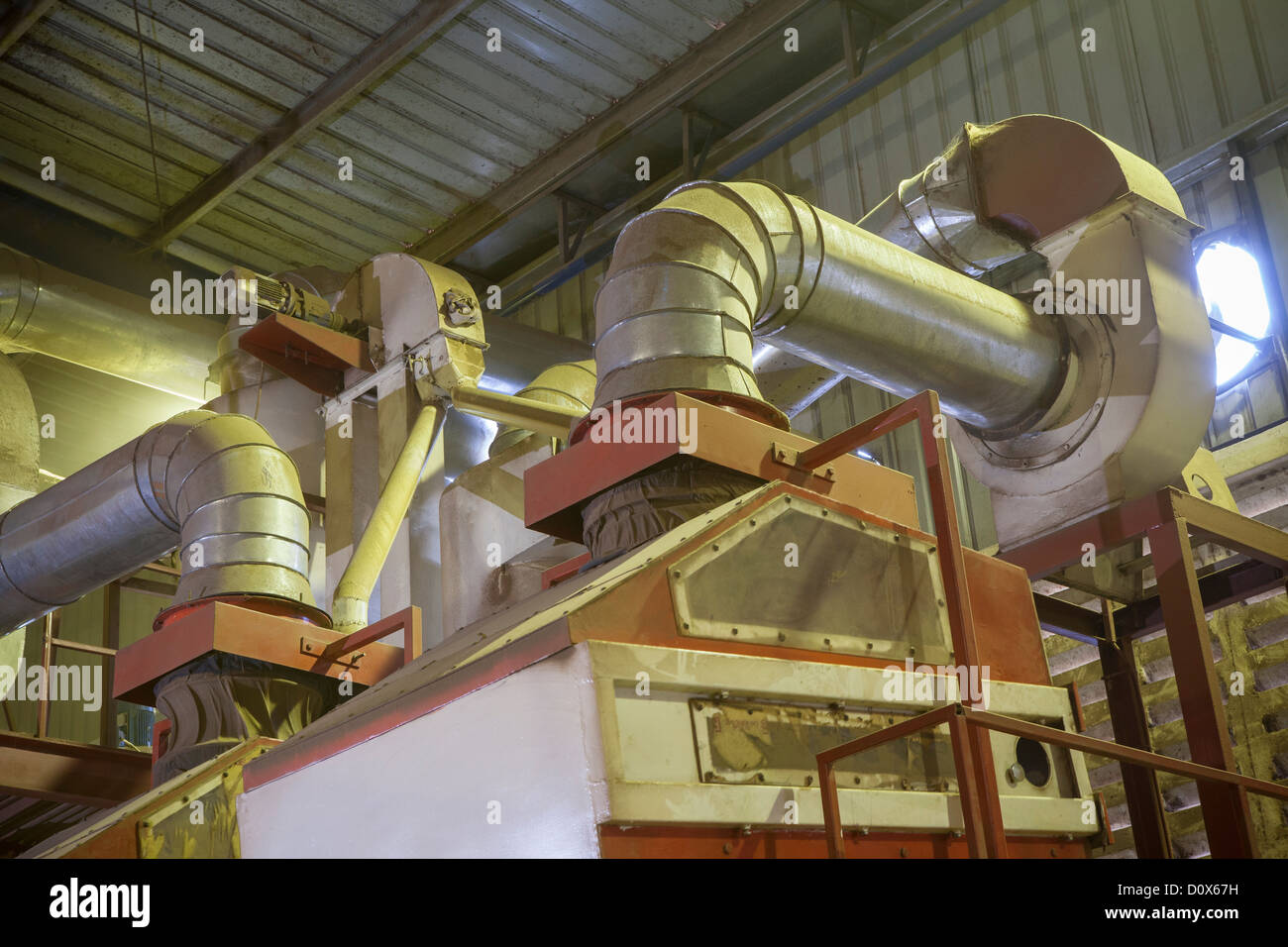 Processing machinery at a commodities warehouse in Dar es Salaam, Tanzania, East Africa. - Stock Image