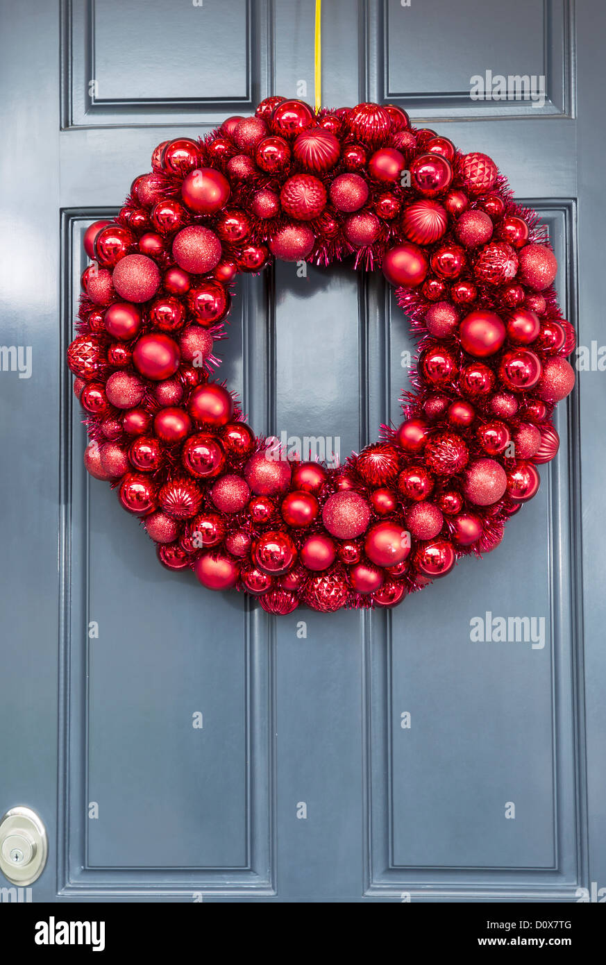 Red Ball Ornaments Wreath Hanging On Outside Of House Door For Holidays