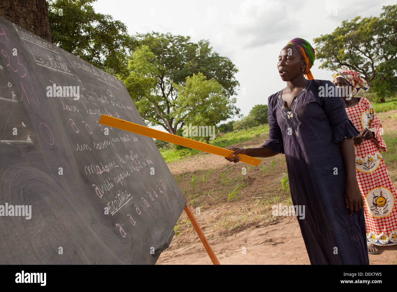 Women learn reading and writing in an adult education class in Doba, Chad, Africa. - Stock Image