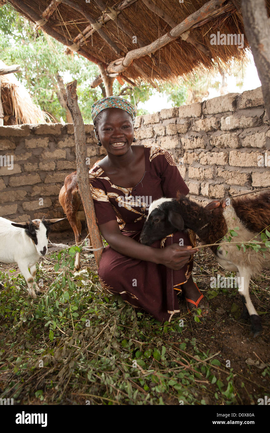 A woman raises goats in Doba, Chad, Africa. - Stock Image