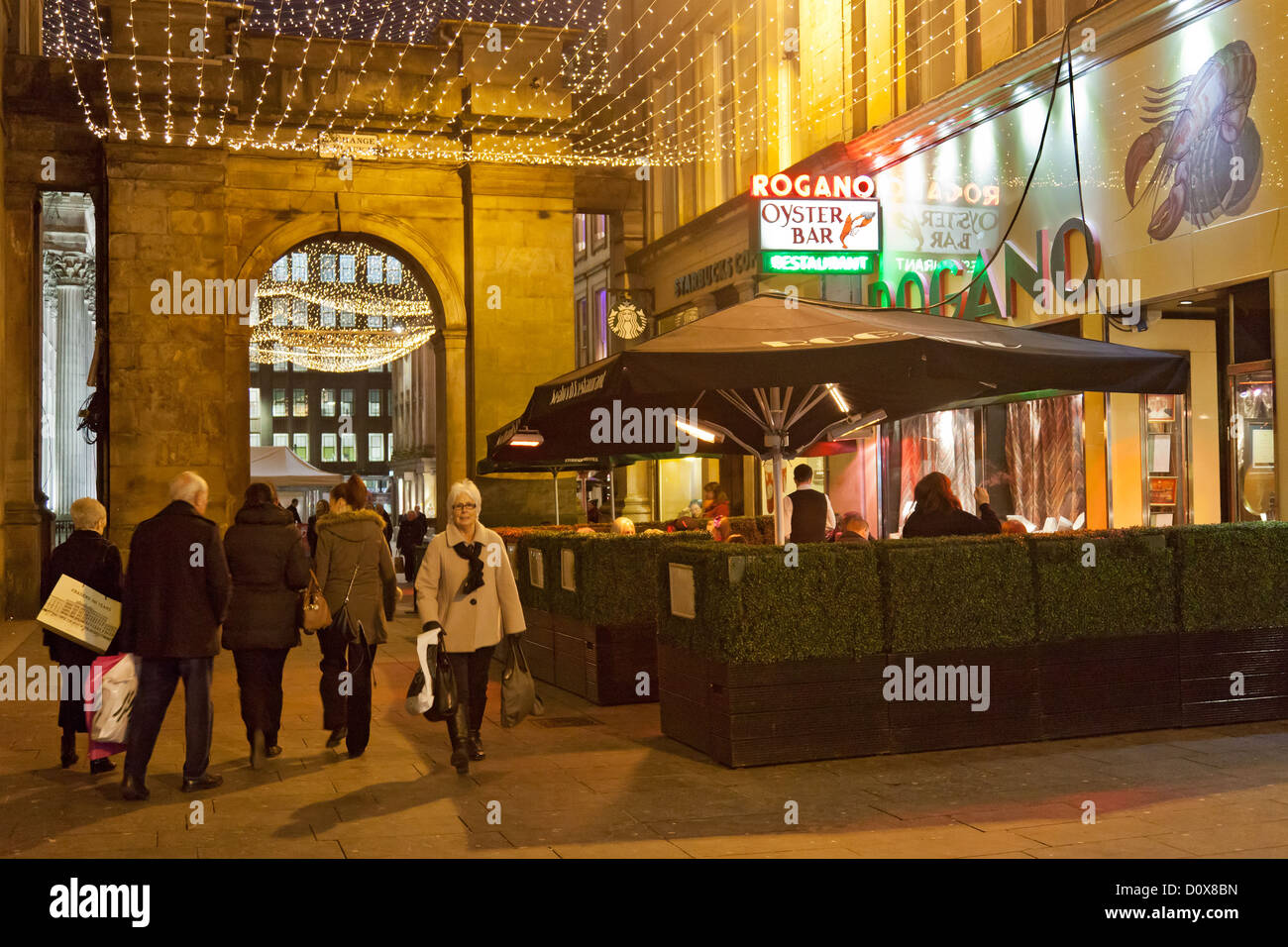 Exchange Place, Glasgow. Pedestrians and diners outside the famous Rogano fish and seafood restaurant and oyster - Stock Image