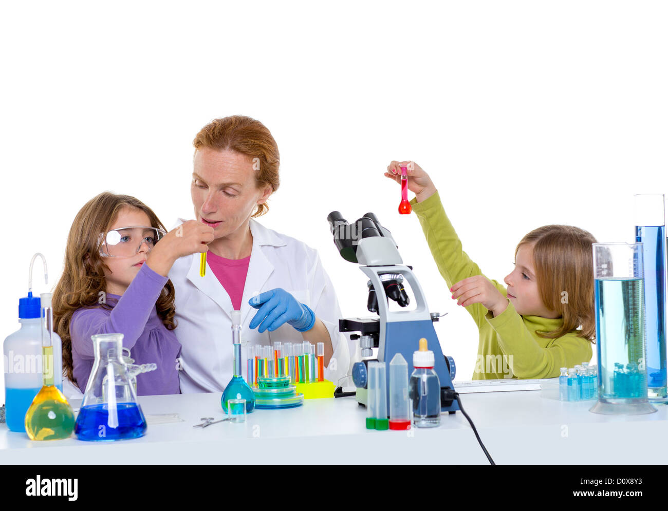 children girls and teacher woman at laboratory on school chemical class - Stock Image