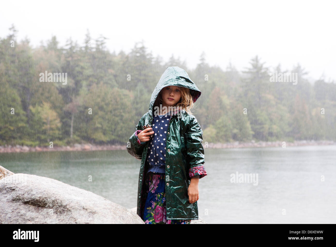 Girl in the rain at Acadia National Park, Maine, USA - Stock Image