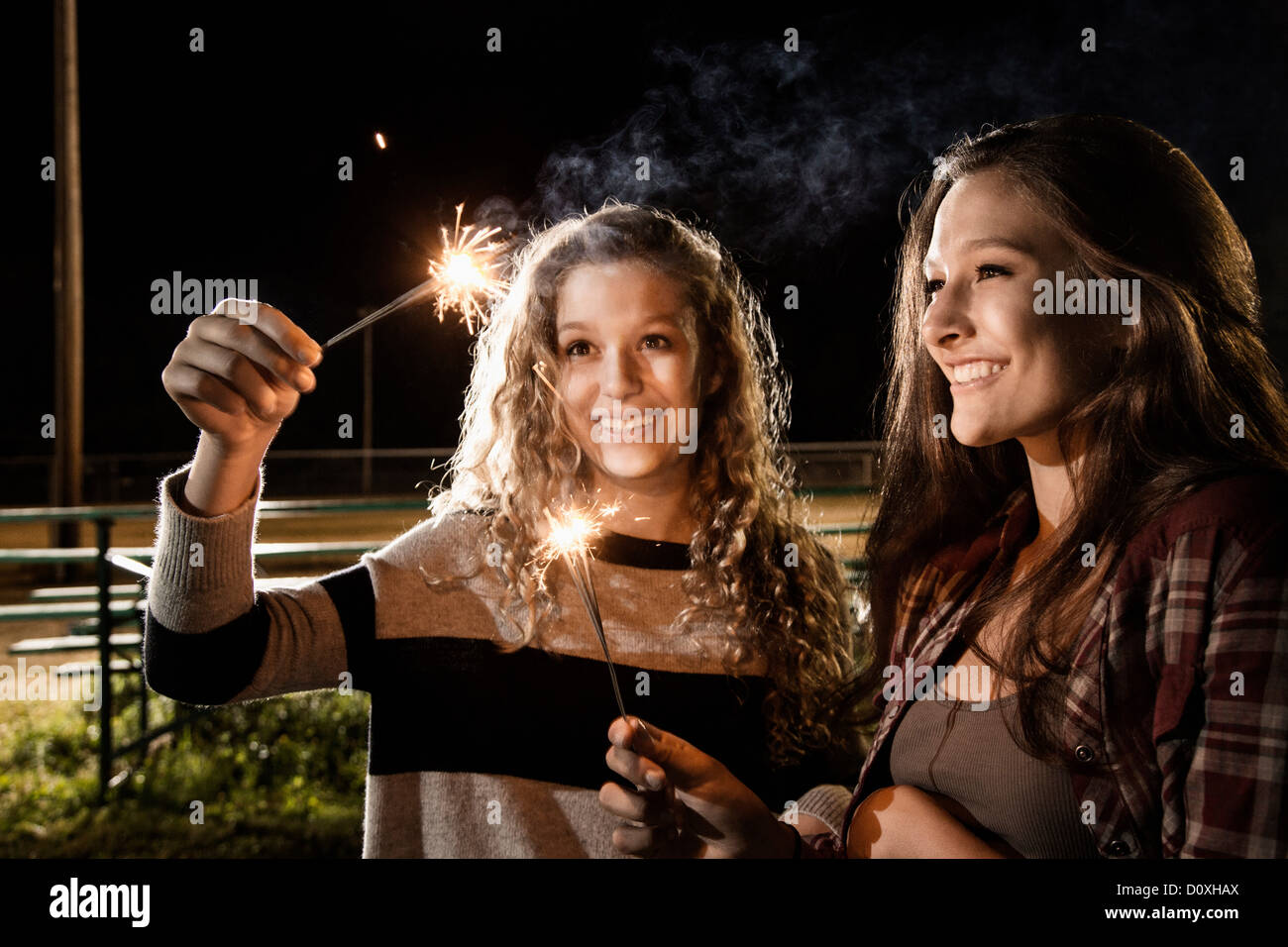 Friends holding sparklers - Stock Image