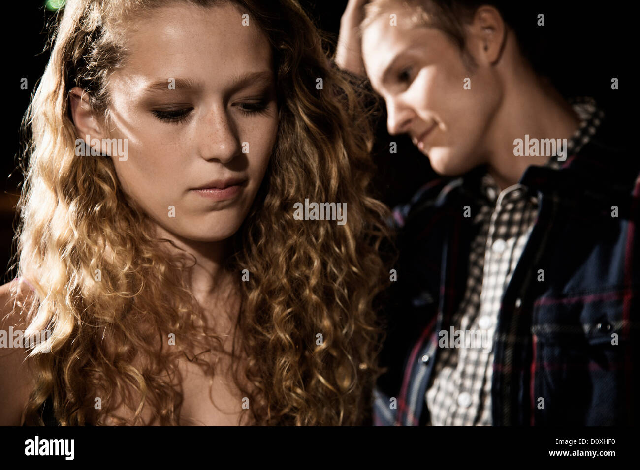 Couple close up, girl looking down - Stock Image