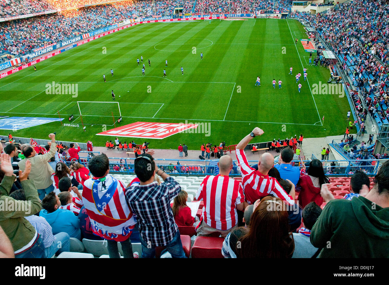 People celebrating a goal in the Atletico de Madrid-Hercules football match. Vicente Calderon stadium, Madrid, Spain. Stock Photo