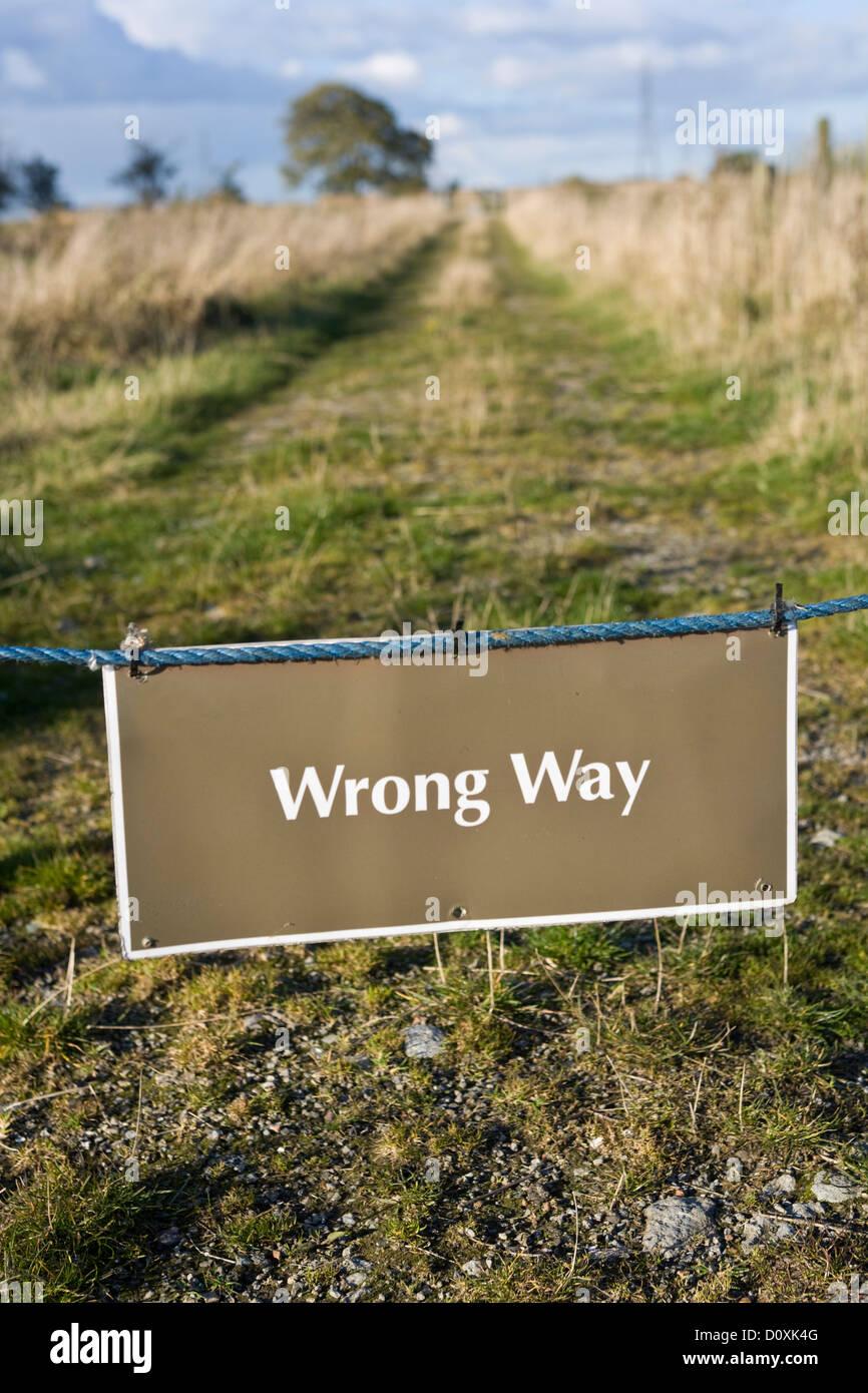 sign saying wrong way - Stock Image