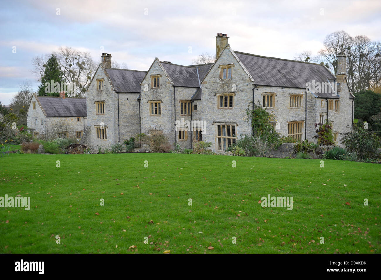 A rural country house in the English countryside that includes architectural features and grounds - Stock Image