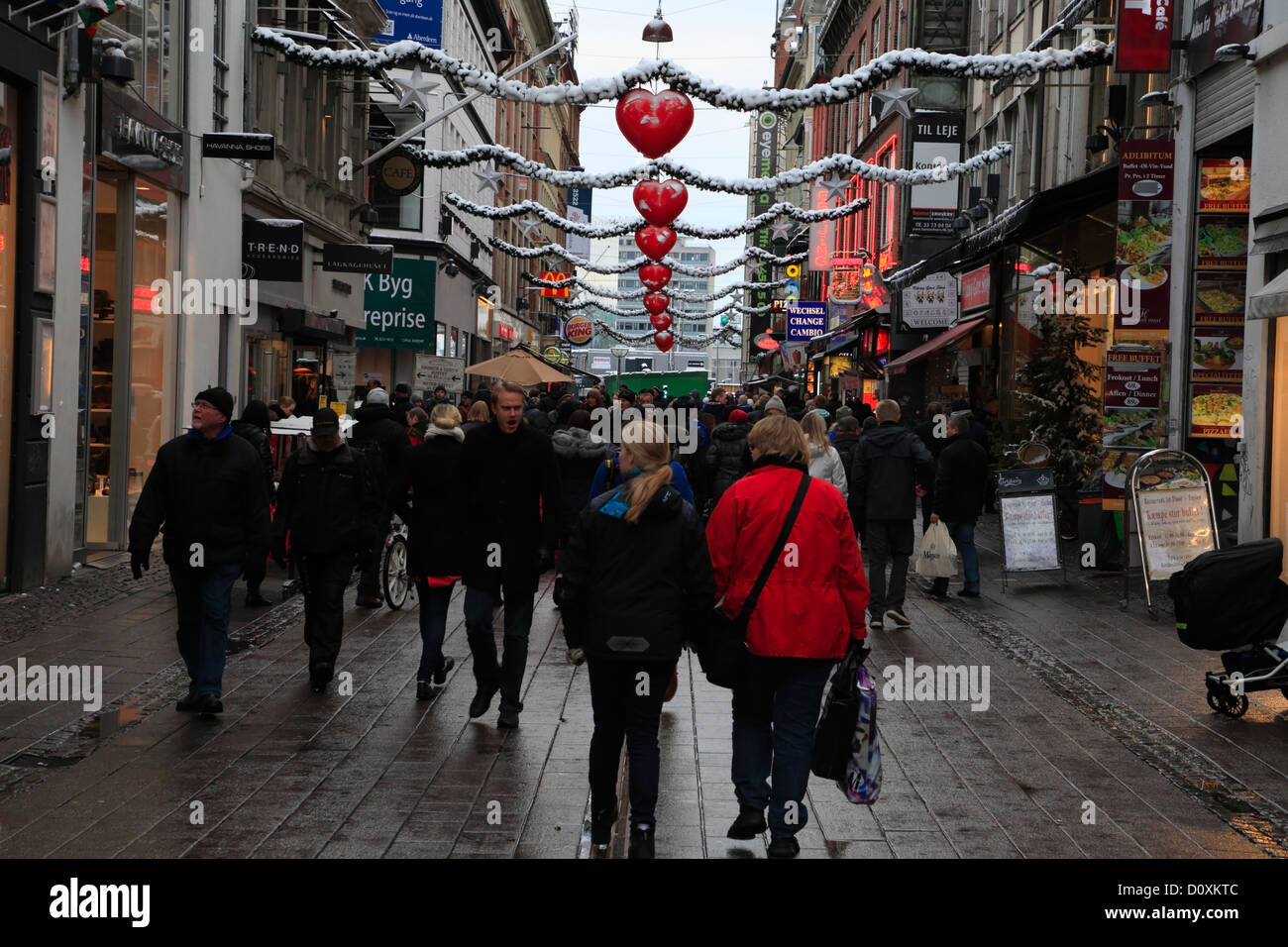 Christmas shopping on the first sunday of Advent in the pedestrian and shopping street Strøget, Stroeget or - Stock Image