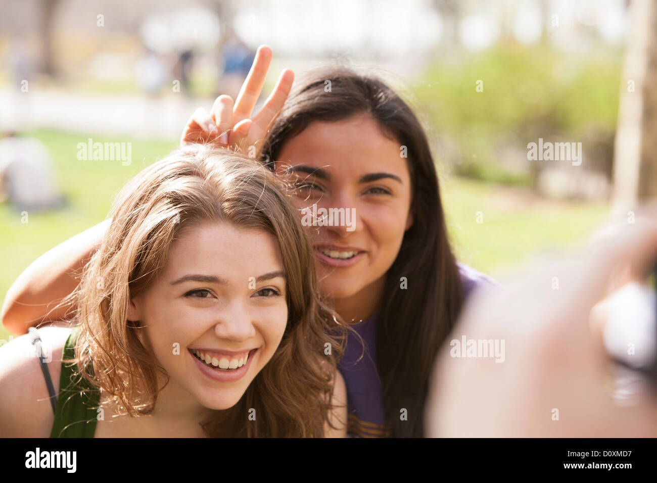 Two young women having their picture taken - Stock Image