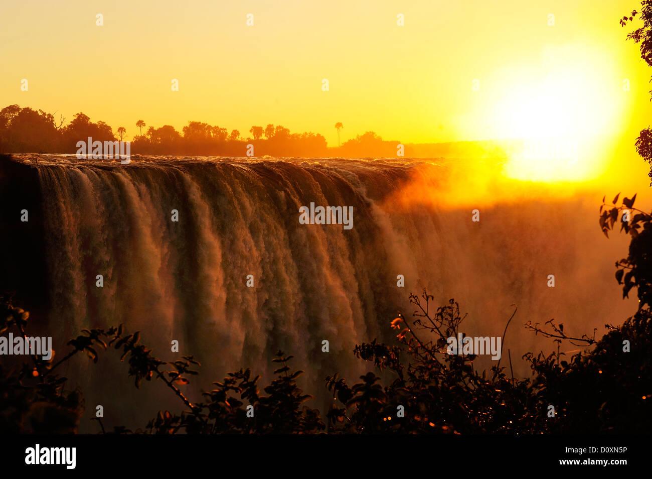 Africa, Zimbabwe, Zambezi, River, Southern Africa, Victoria Falls, waterfall, water, canyon, gorge, sun, sunset - Stock Image
