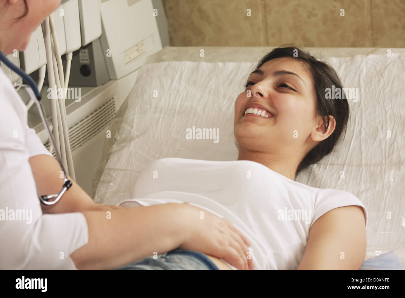Smiling patient on couch - Stock Image