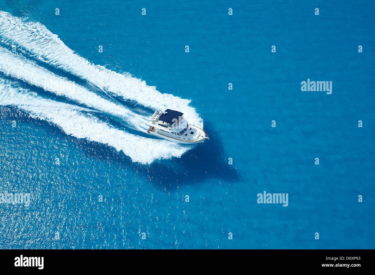 Motor yacht ploughing across blue sea Stock Photo