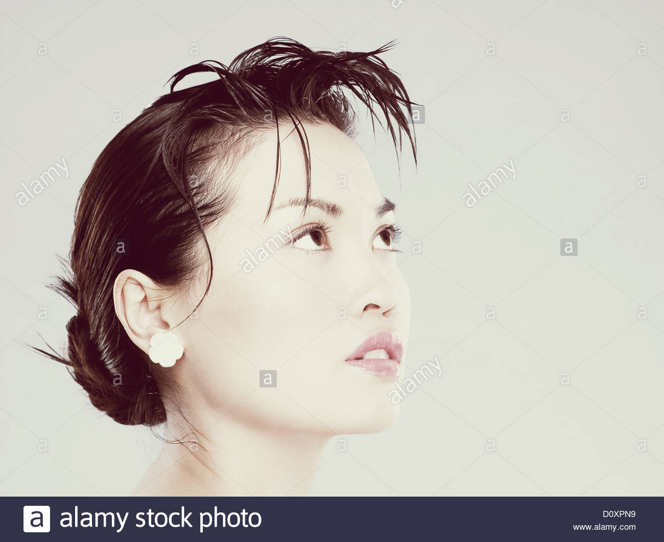 Young woman looking up - Stock Image